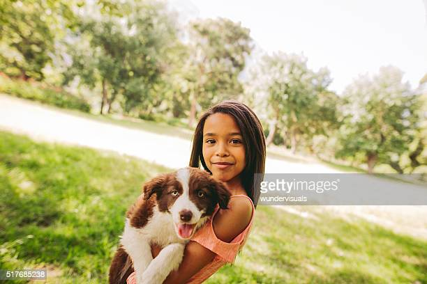 Cute young African-American long haired brunette girl cuddling a