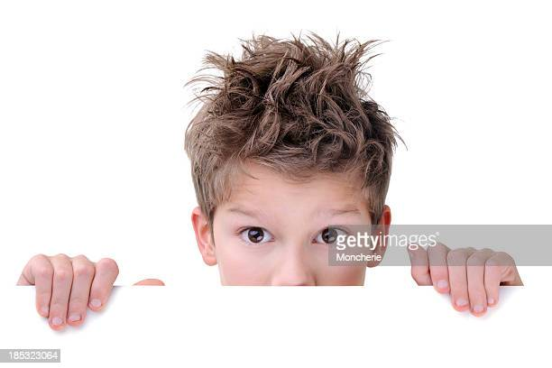Cute Young Boy Hiding Behind An Empty Placard