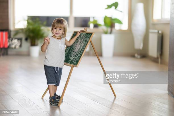 cute young boy with small blackboard