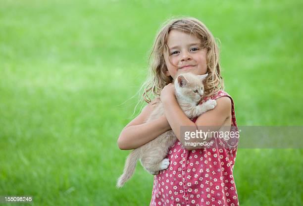 Cute Young Caucasian Girl Holding Kitten