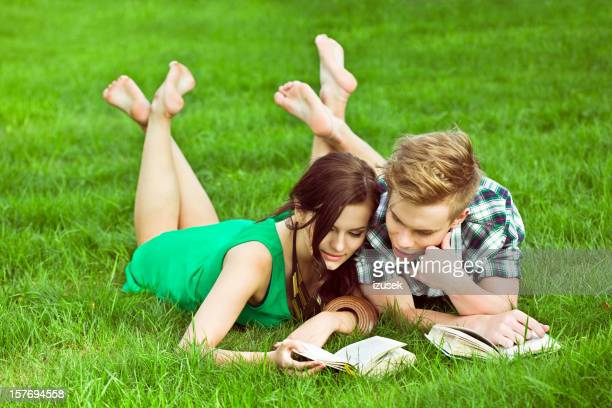 Cute young couple lying on the grass