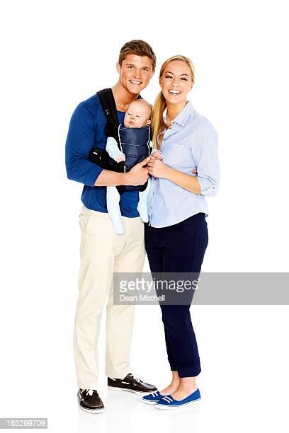 Süße junge Familie auf Weiß