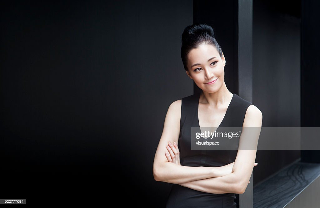 Cute Young Female Entrepreneur Thinking About Her Dreams : Stock Photo