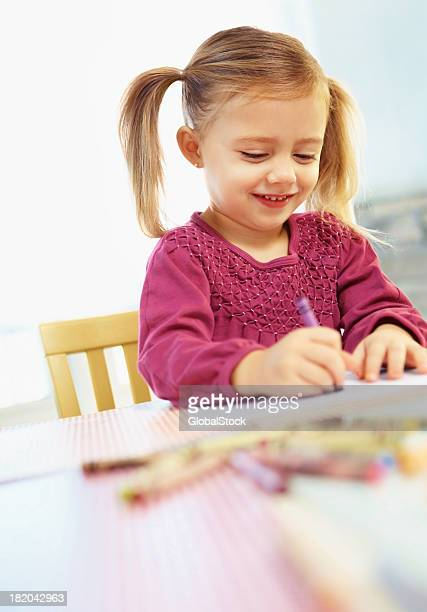 Cute young girl doing her home work