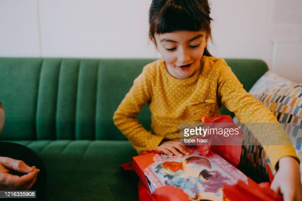cute young girl excited with birthday present - gift stock pictures, royalty-free photos & images