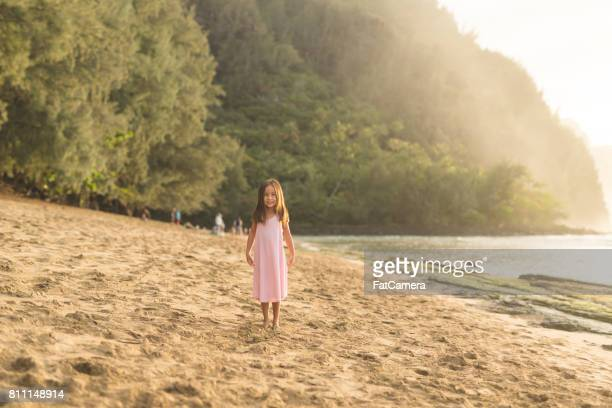 Cute young girl posing for camera on Hawaii beach