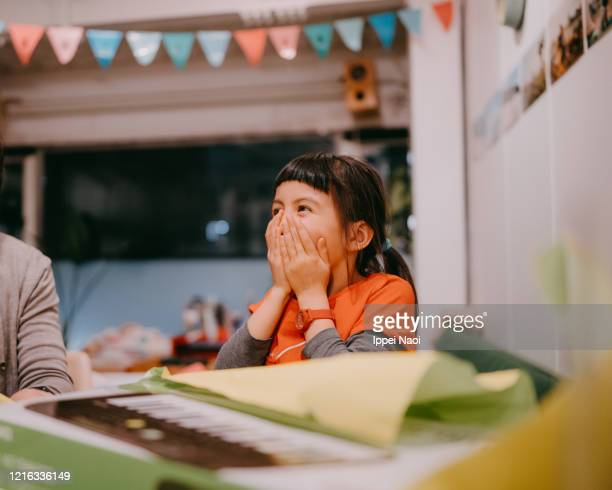 cute young girl surprised and excited with birthday present - gift stock pictures, royalty-free photos & images