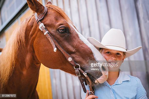 Cute young girl together with her horse