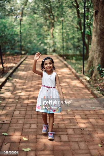 cute young girl (4-5 years) waving hand - 4 5 years stock pictures, royalty-free photos & images