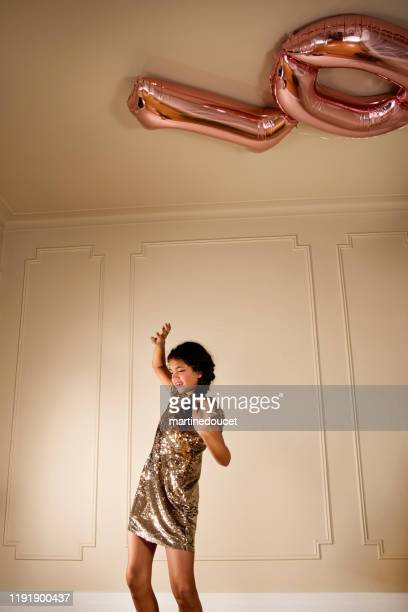 cute young girl with balloons for 10th birthday. - 10 11 anni foto e immagini stock