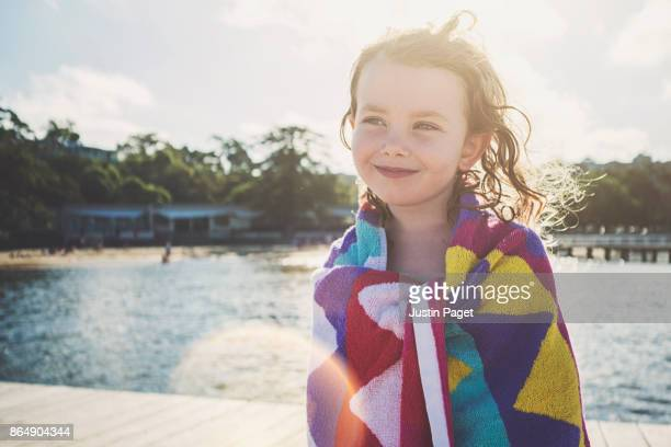 Cute young girl with beach towel