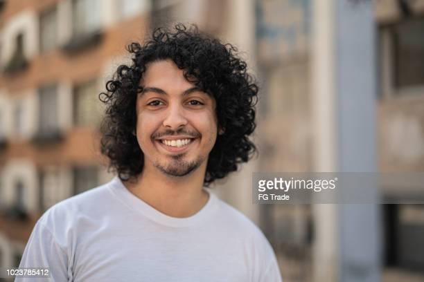 cute young men with curly hair portrait - brazilian men stock photos and pictures