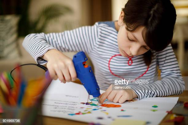 cute young teenage girl doing homework project - art and craft stock photos and pictures