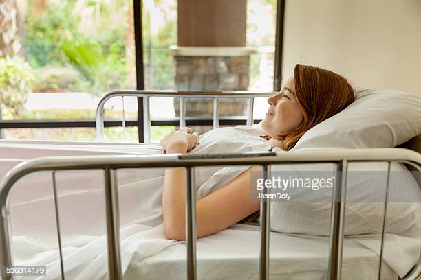 Cute Young Teenager Smilling in a Hospital Bed