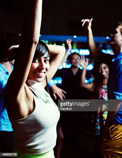 cute young woman enjoying herself dancing in club with friends - male armpits stock pictures, royalty-free photos & images