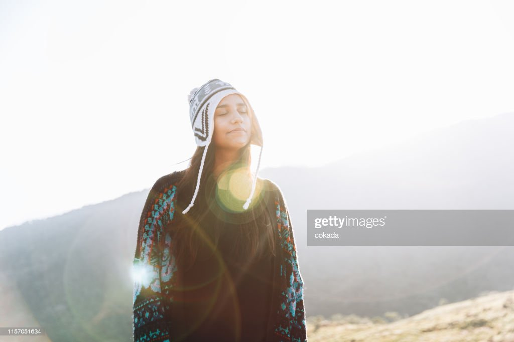Cute young woman enjoying the outdoors : Stock Photo