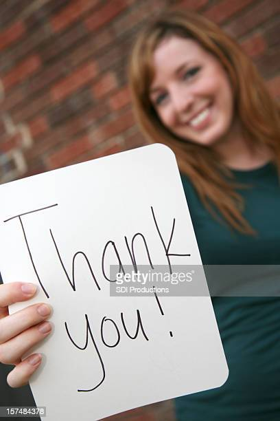 Cute Young Woman Holding a Thank You Sign