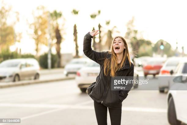 cute young woman - waving gesture stock photos and pictures