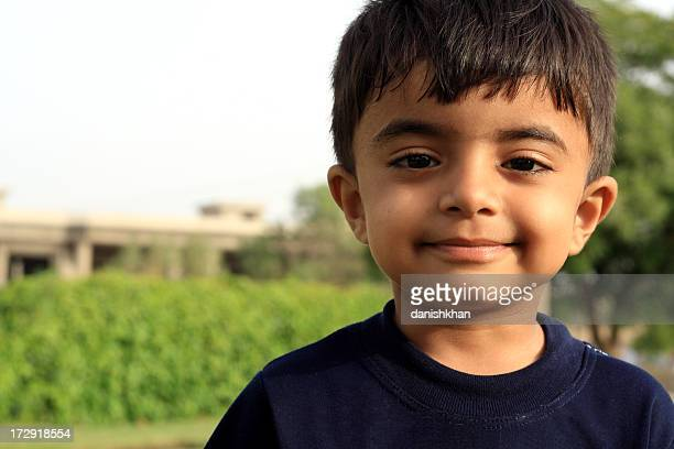 cutest smile - cute pakistani boys stock photos and pictures