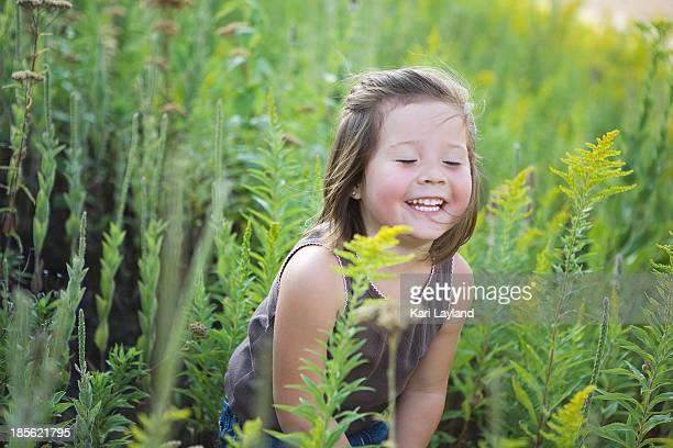 cutie - little girl in nature - ambrosia stock-fotos und bilder