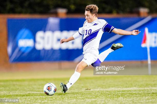 Cutler Coleman of Amherst Mammoths passes the ball during the Division III Men's Soccer Championship held at UNCG Soccer Stadium on December 7 2019...