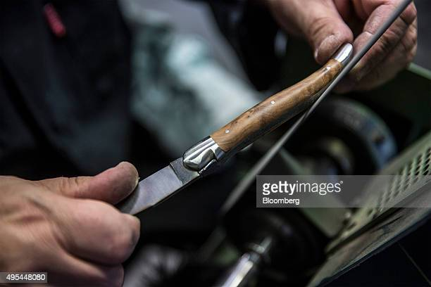 A cutler sands a pocket knife handle during manufacture at Forge De Laguiole traditional knife and cutlery factory in Laguiole France on Monday Nov 2...