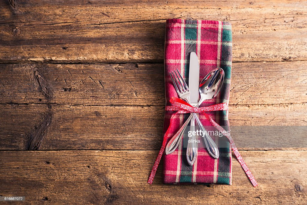 Cutlery on checkered napkin with ribbon branch on wooden background : Stock Photo