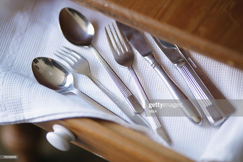 Cutlery on drawer : Stock Photo
