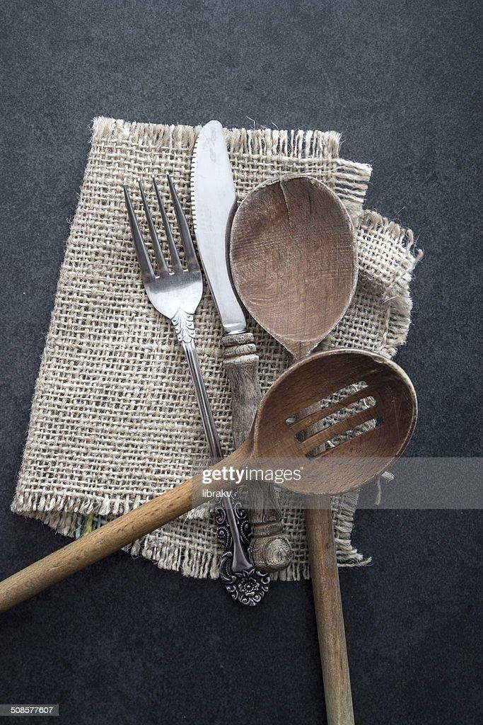 Cutlery strewn across a table. : Stock Photo
