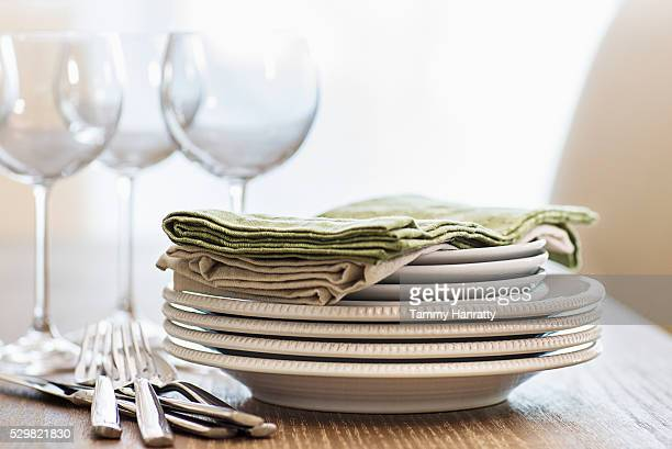 Cutlery, wine glasses, plates and napkins
