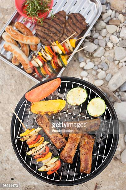 Cutlet, sausages and vegetable kebab on barbecue