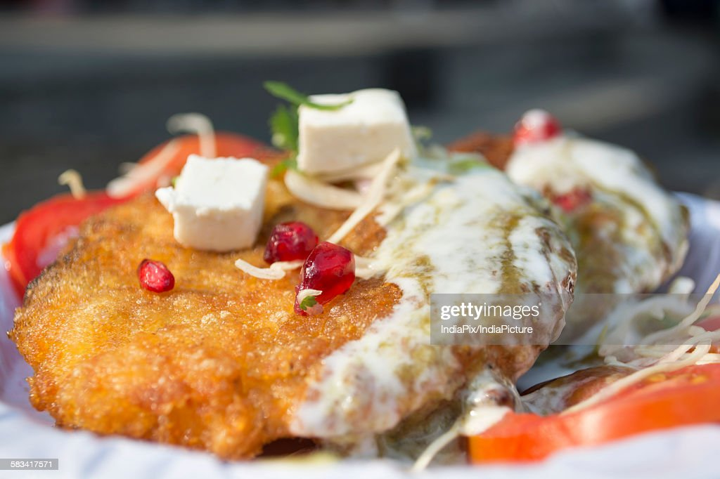 Cutlet with sauce served in a plate : Stock Photo