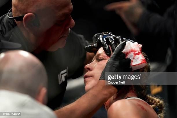 A cutman tends to Katlyn Chookagian between rounds of her women's flyweight championship against Valentina Shevchenko of Kyrgyzstan bout during the...