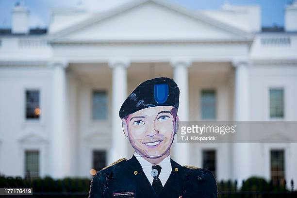 A cutout of Bradley Manning is held up on August 21 2013 in front of the White House in Washington DC Manning was sentenced to 35 years in prison for...