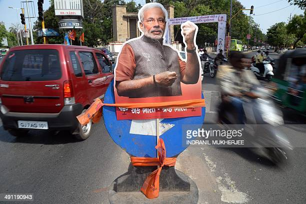 A cutout of Chief Minister of western Gujarat state and main opposition Bharatiya Janata Party prime ministerial candidate Narendra Modi is fixed...