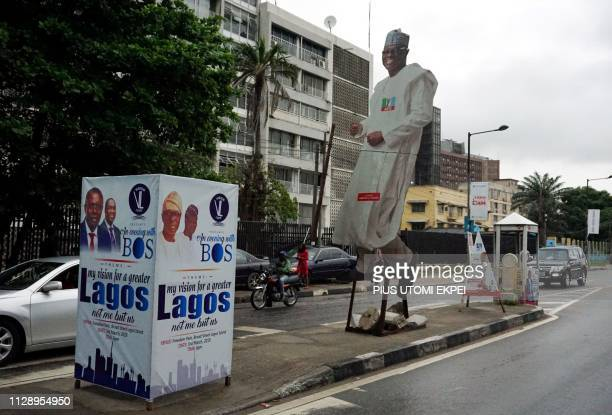 A cutout portrait of Nigeria's gubernatorial candidate from the ruling All Progressives Congress party in Lagos Babajide SanwoOlu and a portrait of...