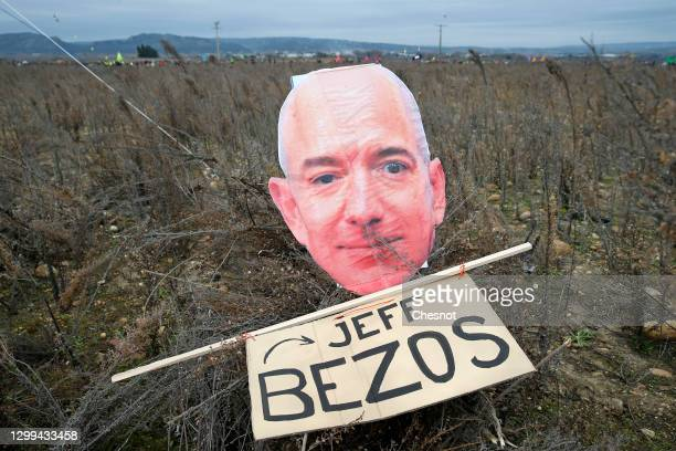 Cutout sign depicting Amazon CEO Jeff Bezos is seen during a rally against plans to build a giant Amazon warehouse on January 30, 2021 in Fournes ,...