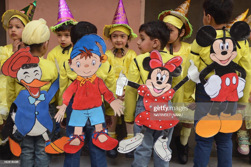 Cutouts of Disney cartoon characters are pictured on the backs of Indian schoolchildren before participating in a play at a school in Amritsar on February 28, 2013. Standards of education in rural areas in India are declining despite huge investments by the government and landmark legislation guaranteeing schooling to all children, according to a major new study released January 2013.