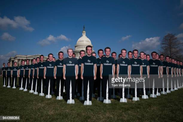 Cutouts of Facebook CEO Mark Zuckerberg appear on the east lawn of the Capitol ahead of his testimony before a joint hearing of the Senate Judiciary...