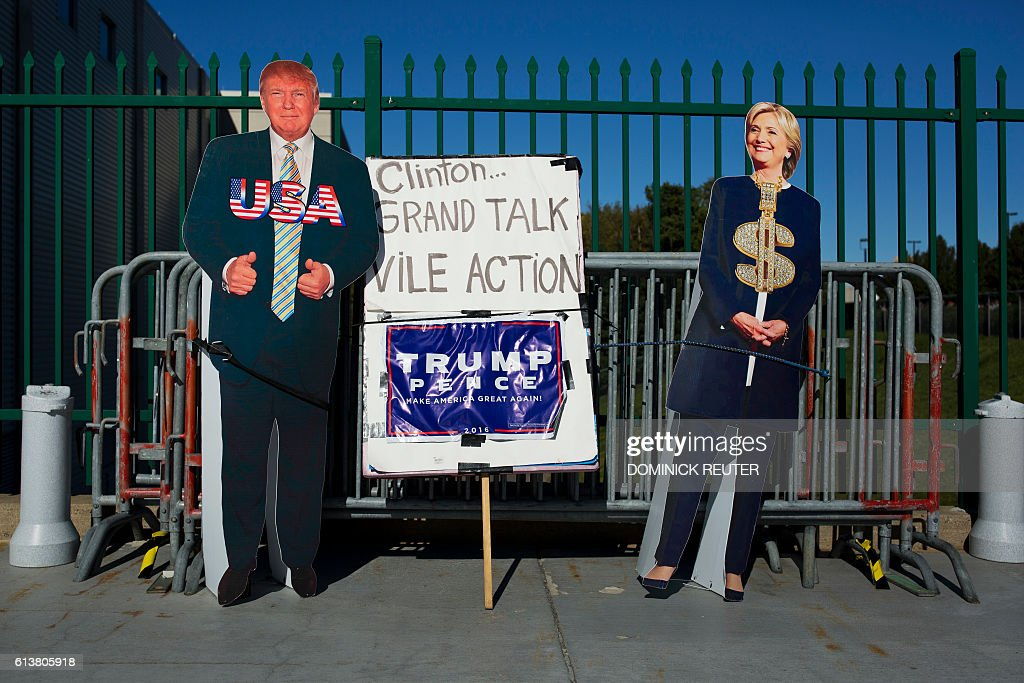 Cutouts of presidential nominees, Republican Donald Trump and Democrat Hillary Clinton are propped up against barricades outside the Mohegan Sun Arena before a Trump rally, October 10, 2016, in Wilkes Barre, Pennsylvania. / AFP / DOMINICK