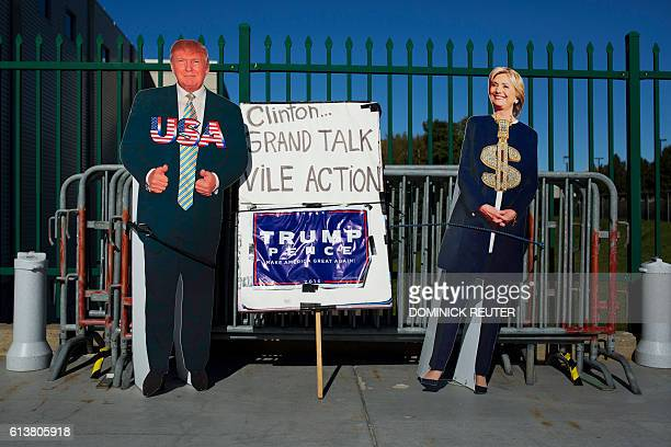 Cutouts of presidential nominees Republican Donald Trump and Democrat Hillary Clinton are propped up against barricades outside the Mohegan Sun Arena...
