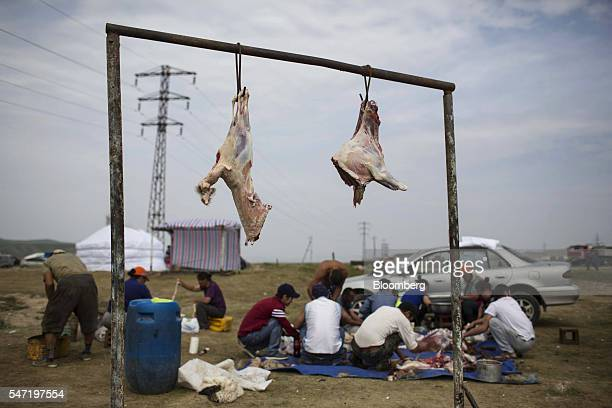 Cuts of a sheep's carcass hang at a livestock market on the outskirts of Ulaanbaatar Mongolia on Wednesday July 13 2016 The nation's growth slowed to...