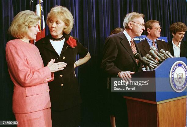 CUTSen Kay Bailey Hutchison RTexas and Jennifer Dunn RWash consult left during a news conference on tax cut legislation Sen Paul Coverdell RGa Sen...