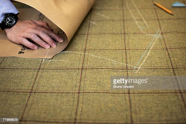Cutter marks out a pattern in Huntsman tailors on August 14, 2006 in London, England. With the commercial expansion of nearby tourist shopping areas,...