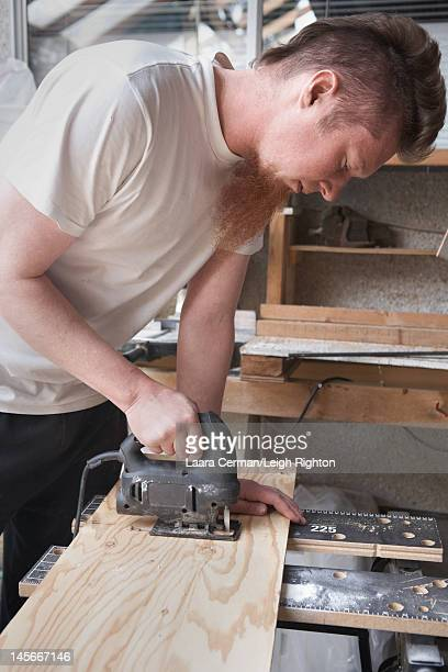 Cutting a hole in wood.