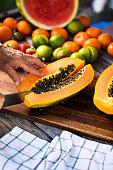 cutting papaya