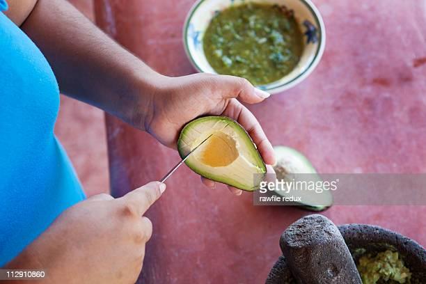 Cutting avocado to make guacamole