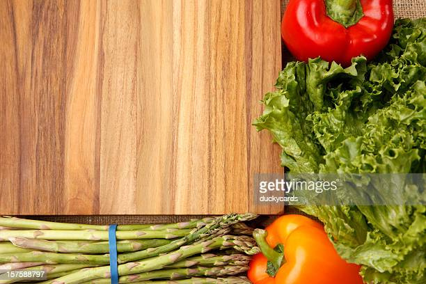cutting board and fresh veggies background - leaf lettuce stock pictures, royalty-free photos & images