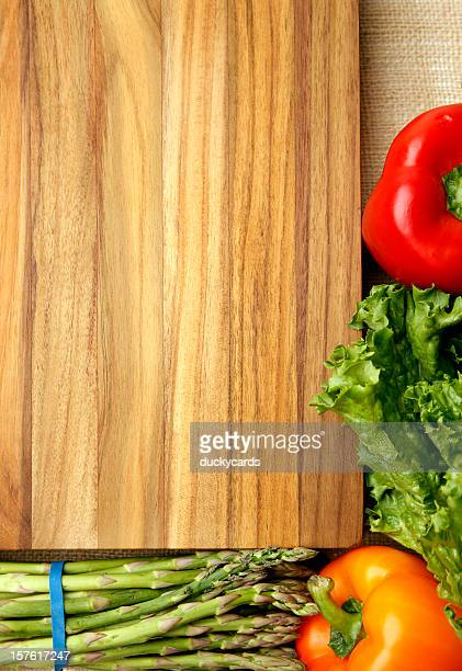 Cutting Board and Fresh Veggies Background