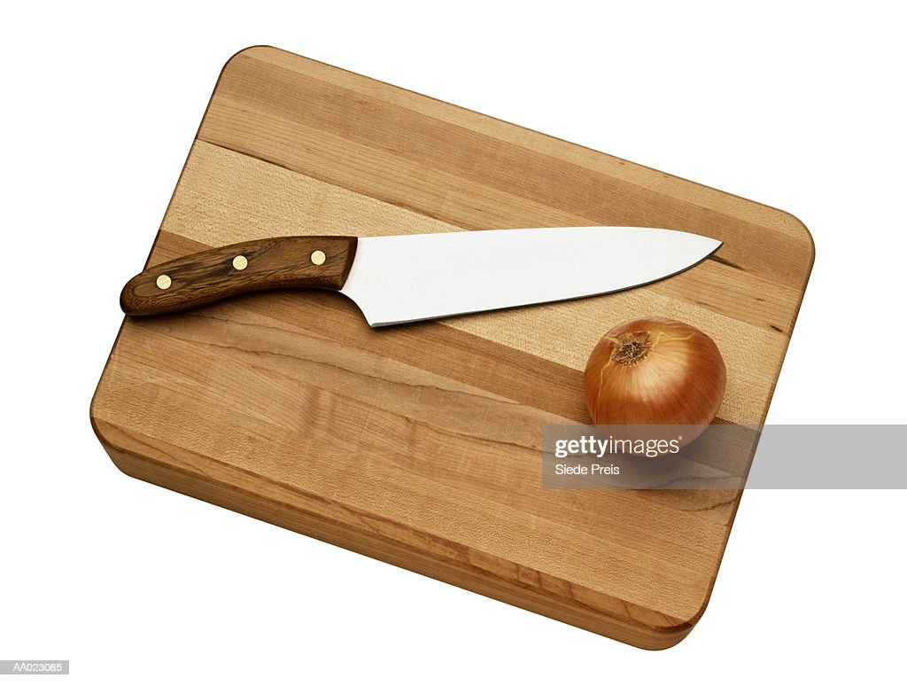 Cutting Board With A Knife And An Onion Stock Photo Getty